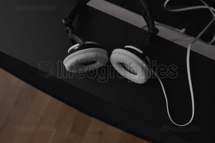 Headphones and central middle speakers from a 7.1 THX Hi-Fi sound system