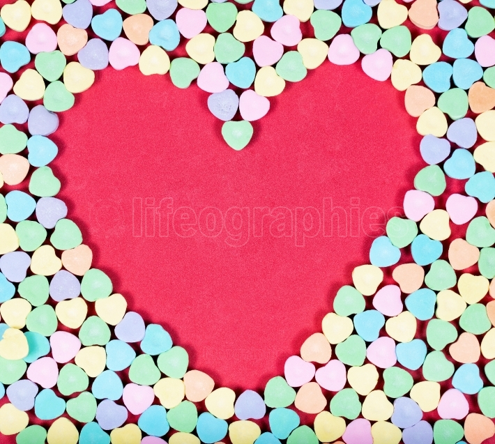 Heart blank space with colorful candies on outside