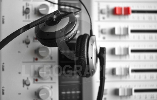 High fidelity sound guard headphones over sound mixer