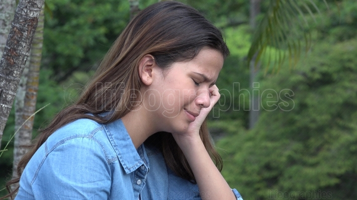 Hispanic Teen Girl Crying With Emotional Pain