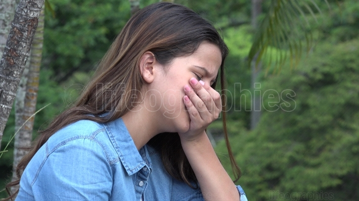 Hispanic Teen Girl Tearful With Emotional Pain