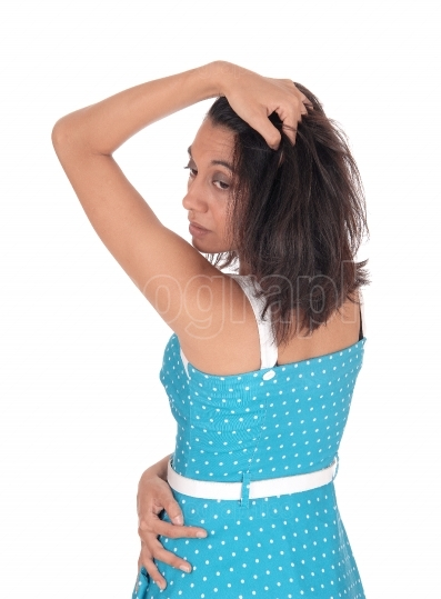Hispanic woman in blue dress from the back