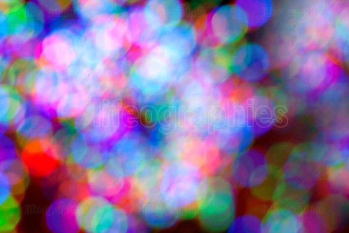 Holiday lights create colorful bokeh background