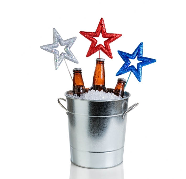 Holiday stars and bucket of ice and cold beer on white backgroun