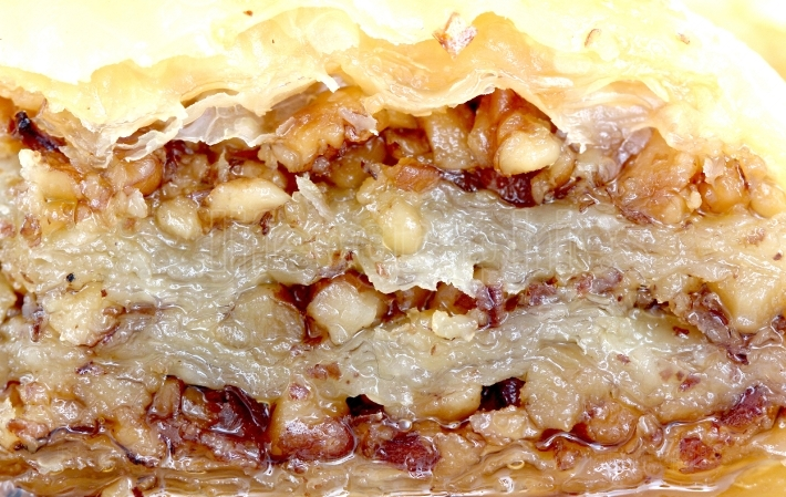 Homemade turkish baklava with walnuts and sweet syrup