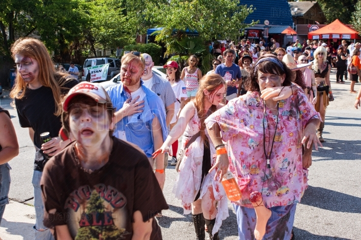 Horde of bloody zombies staggers along at atlanta pub crawl