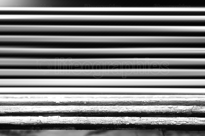 Horizontal black and white bench bokeh background
