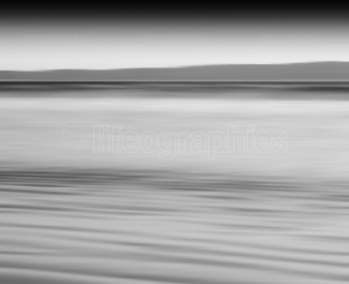 Horizontal black and white ocean milk motion blur abstraction ba