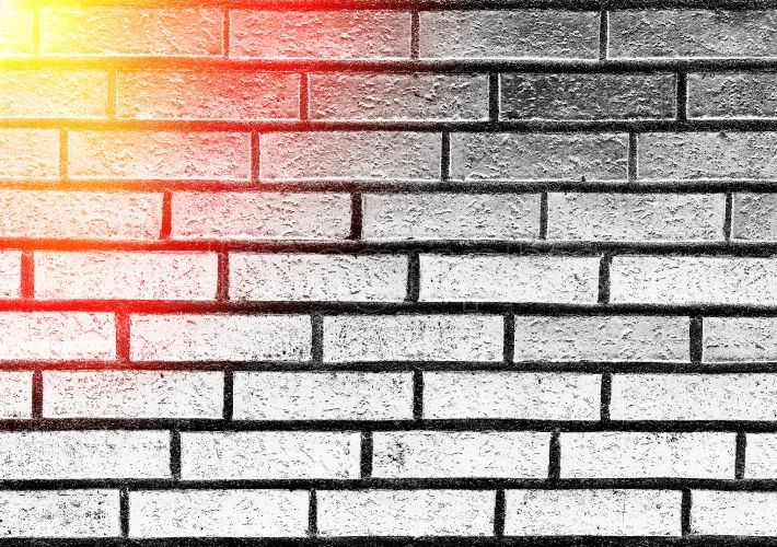 Horizontal brick wall texture with light leak background
