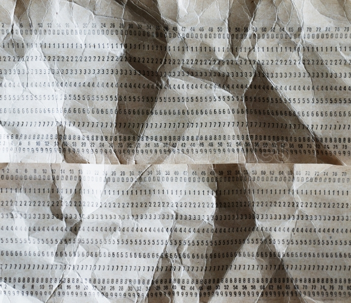 Horizontal crumpled punched cards background