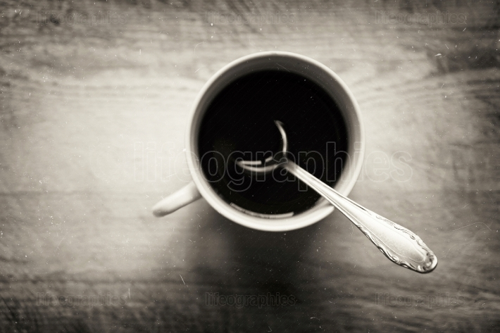 Horizontal cup with spoon bokeh background