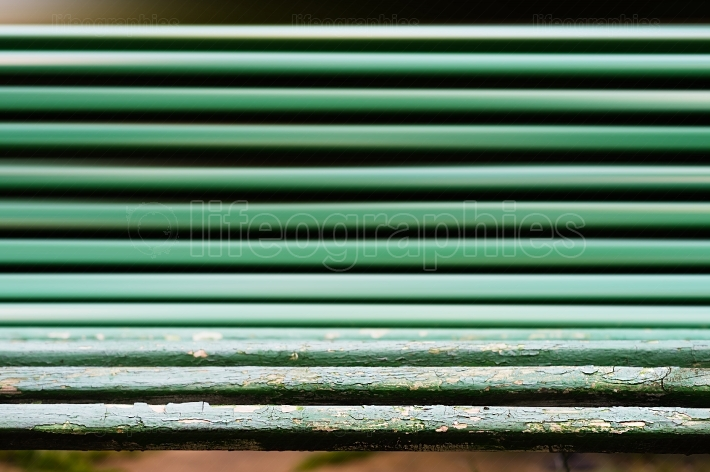 Horizontal dramatic park bench bokeh background