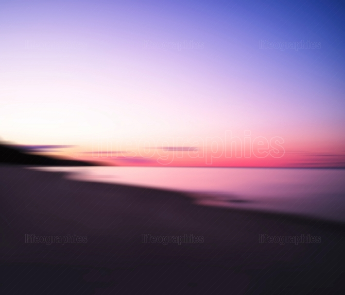 Horizontal dramatic sunset on lake abstract bokeh background