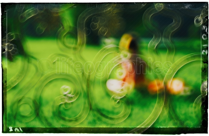 Horizontal girl in park bokeh abstraction background