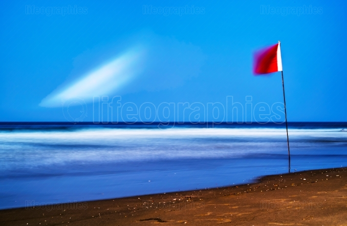 Horizontal red flag of freedom beach landscape background