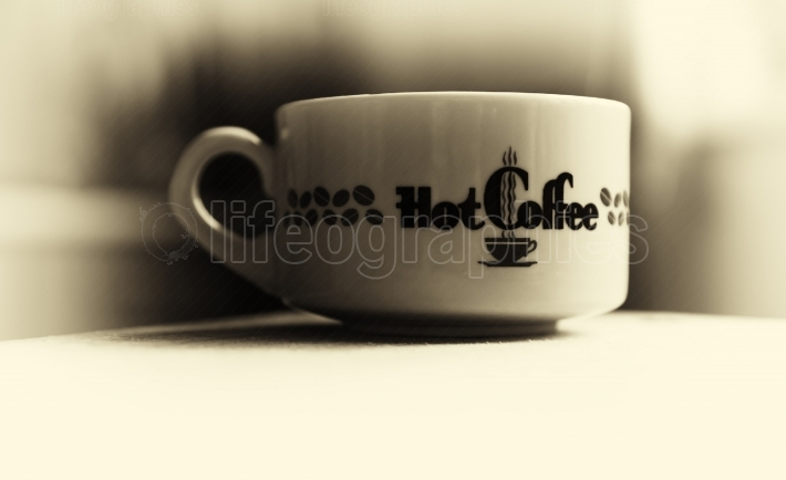Horizontal vintage hot cup of coffee bokeh vignette background