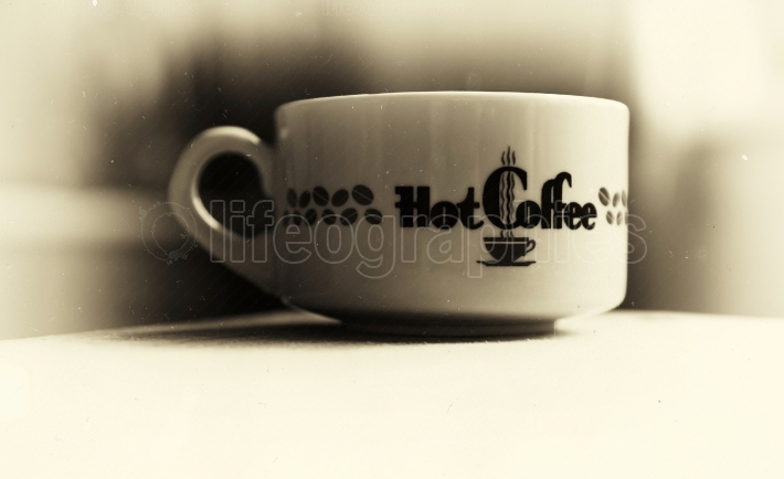 Horizontal vintage hot cup of coffee bokeh vignette background w