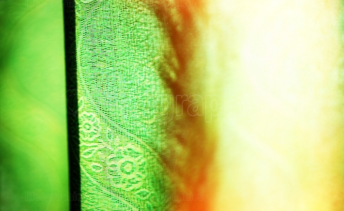 Horizontal vivid green curtain with light leak bokeh background