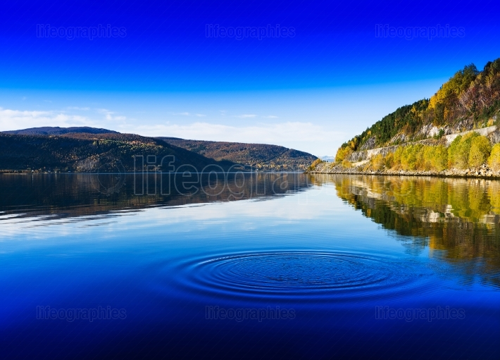 Horizontal vivid Norway day river water circles drops background