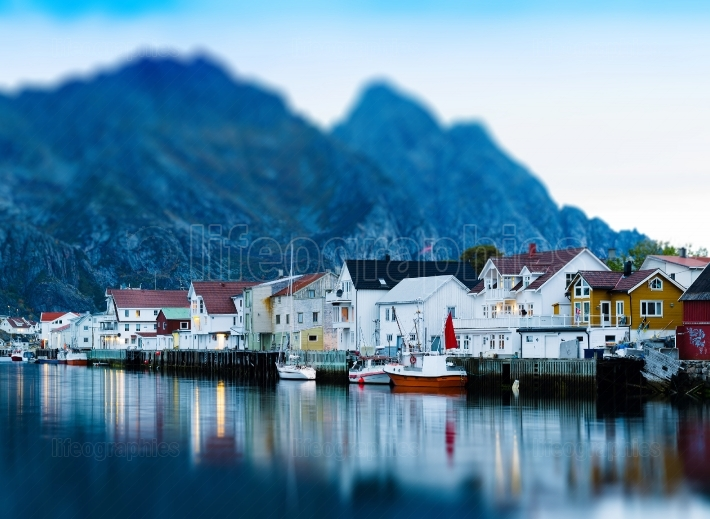 Horizontal vivid Norway town mountain pier reflections lights ba