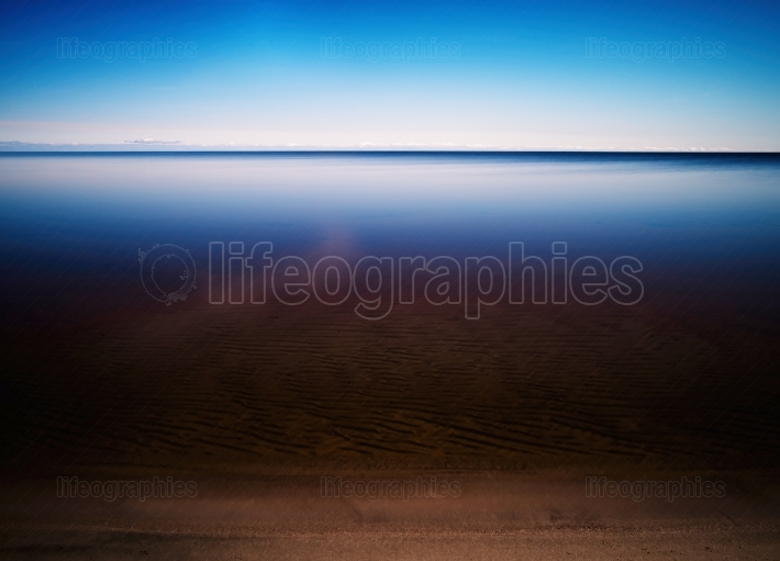 Horizontal vivid smooth mountain lake beach sand landscape