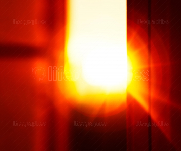 Horizontal vivid sunset light flare through window abstract back