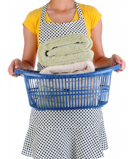 Housewife Holding a Laundry Basket of Towels