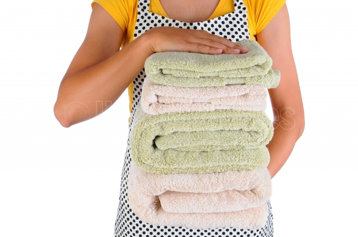 Housewife Holding a Stack of Towels