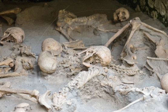 Human skulls and bones at the ruins of Herculaneum, Naples, Italy