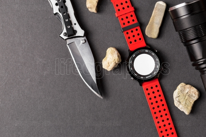 Hunting objects, folding hunting knife , red smartwatch and blac