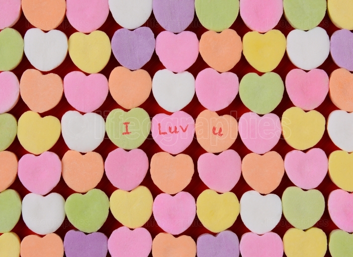 I Luv U on Candy Hearts closeup