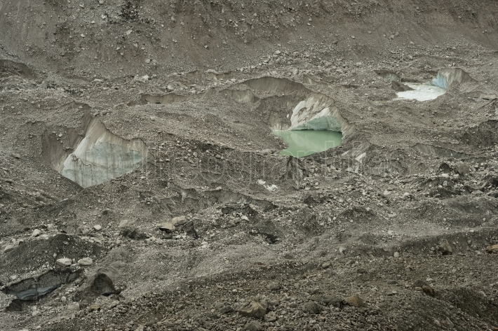 Ice lakes from Khumbu glacier and stones and ice formations. Himalaya. Nepal