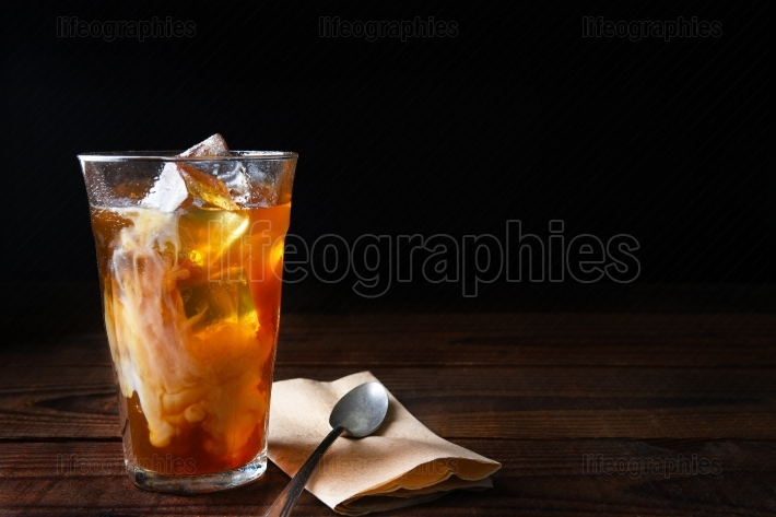 Iced Coffee on Wood Table With Spoon