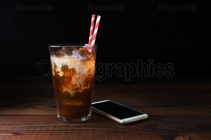 Iced Coffee on Wood Table With Straws