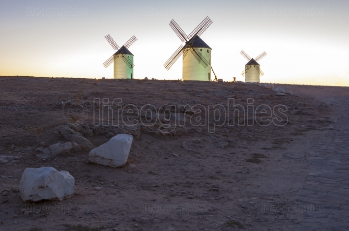 Illuminated traditional windmills at rising