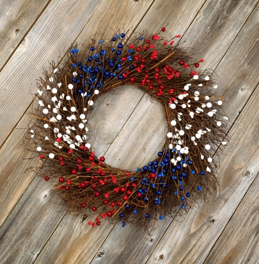 Independence Day wreath on rustic wooden boards