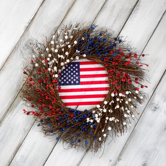 Independence Day wreath with flag on rustic white wooden boards