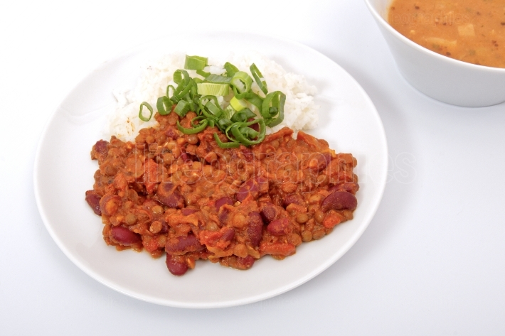Indian legume hash with rice on a white