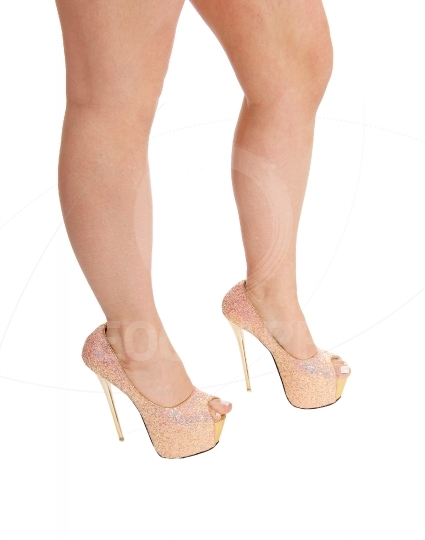 Isolated woman legs with heels.