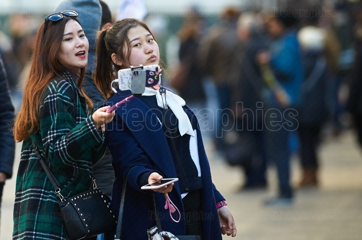 ITALY- FLORENCE, DECEMBER 2016: Young asian girl taking a selfie