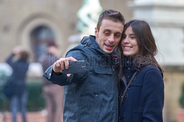 Italy- florence, december 2016: young people taking a selfie in