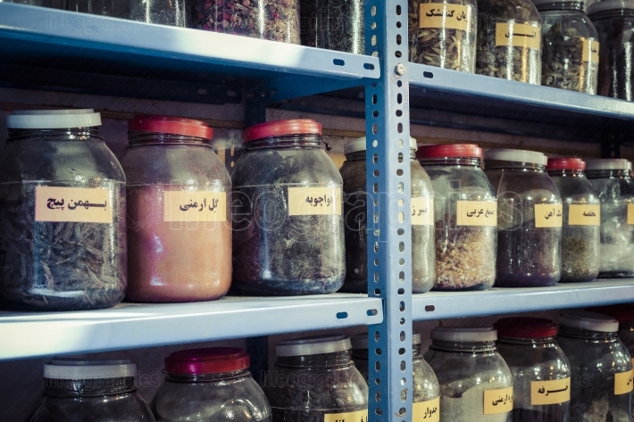 Jars of herbs and powders in a iranian spice shop.