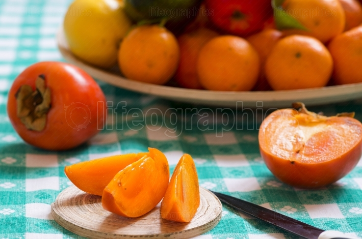 Khaki fruit slices on a table