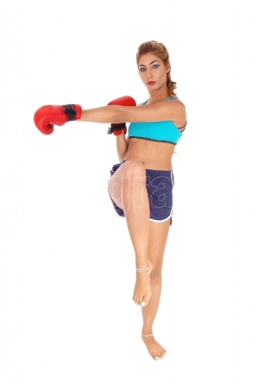 Kickboxing young woman.