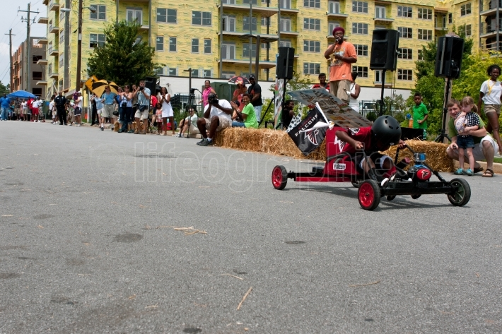 Kid Steers Car Down Hill In Atlanta Soap Box Derby