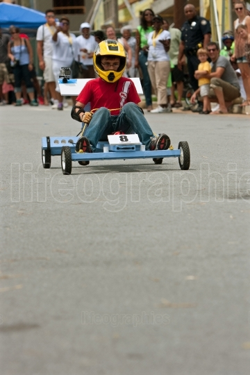 Kid Steers Homemade Car in Atlanta Soap Box Derby Event