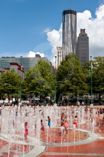 Kids and families enjoy playing in atlanta centennial park fount