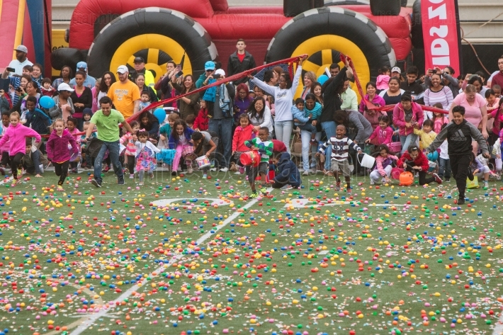 Kids Dash Onto Football Field For Community Easter Egg Hunt