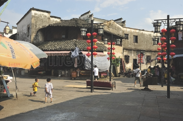 Kids playing on the streets of old city of Huangshan