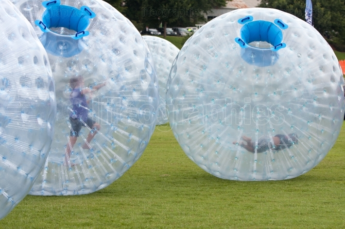 Kids Roll Around In Large Zorbs At Summer Festival